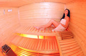 Girl in small sauna — Stock Photo