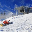 Modern cableway and groomer in ski resort Jasna, Slovakia — Stock Photo #38796623