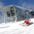 Modern cableway and groomer in ski resort Jasna, Slovakia — Stock Photo #38797043