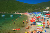 Beach with blue flag at the bay of Kotor, Montenegro — Stock Photo