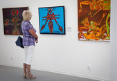 Woman looking at the painting in the gallery Danubiana, Bratisla — Stock Photo