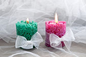 Two colorful candles with ribbons around — Stock Photo