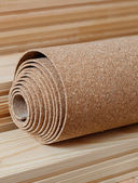 A roll of cork lies on the floor battens — Stock Photo