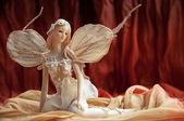 A statuette of ballerina with wings. — Stock Photo