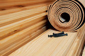 Roll of cork and some nails are on the wooden battens — Stock Photo
