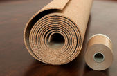 Roll of cork with Painting edging tape on a brown floor — Stock Photo