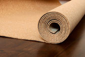 Roll of cork lies on a brown floor — Stock Photo