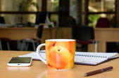 Cup of tea on the office table — Stock Photo