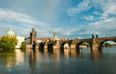 Old bridge across the wide river. Prague — Stock Photo