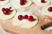 Cooking dumplings with sweet cherries — Stock Photo