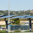 Solar power plant on the road - Stock Photo