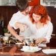 Stock Photo: Young pair on kitchen: making pastry together