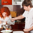 Royalty-Free Stock Photo: Young pair on the kitchen: making pastry together