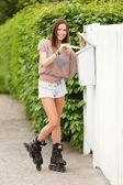Postman on roller skates — Zdjęcie stockowe