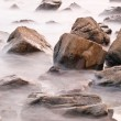 Rocks in faded sea — Stock Photo