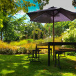 Dining table with parasol — Stock Photo #14687561