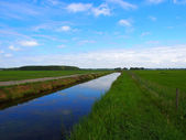 Channel in dutch farmland — Stock Photo