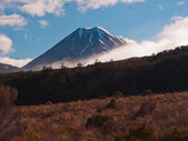 A look through the clouds of a volcano in de morning — Stock Photo