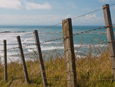 Seascape over fence — Stock Photo
