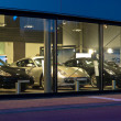 Luxury cars at a dealership - Stock Photo