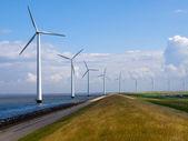 Row of windturbines along motorway — Stock Photo