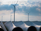 Wind turbine blades awaiting assembly at wind farm — Stock Photo