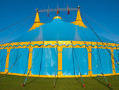 Close up of a blue and yellow big top circus tent — Stock Photo