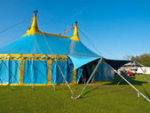 Main entrance of a blue and yellow big top circus tent — Stock Photo