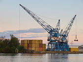 Two cranes are waiting for cargo in a dutch harbour — Stock Photo