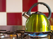 Green kettle — Stock Photo