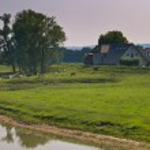 Old vintage buildings in european riverside landscape — Stock Photo
