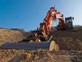 Cavador de construcción en un arenero — Foto de Stock