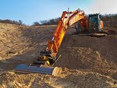 Heavy orange excavator — Stock Photo
