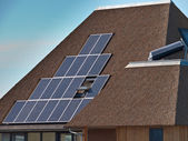 Solar panels on a thatched roof — Stock Photo