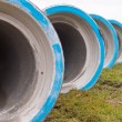 Row of concrete construction pipes — Stock Photo