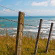Stock Photo: Seascape over fence