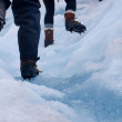 Group of tourists trekking on a glacier — Stock Photo