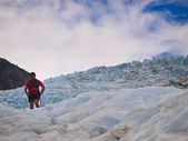 Glacier guide is looking down — Stock Photo