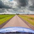 Stock Photo: Straight Road under Brooding Sky