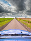Straight Road under Brooding Sky — Stock Photo