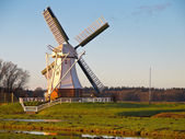 White windmill against blue sky — Stock Photo