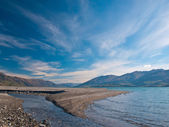 Rivermouth with Pebbles and Stones — Stock Photo
