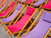 Colorful beach chairs background — Stock Photo