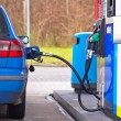 Blue car at gas station — Stock Photo