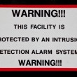 Stock Photo: Facility Alarm System Sign