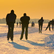 Stock Photo: Skaters under setting sun