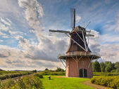 Dutch Windmill besides a Canal — Stock Photo