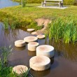 Step stones over water — Stock Photo