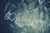 Love symbols on chalkboard — Stock Photo
