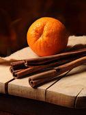 Cinnamon and orange — Stock Photo